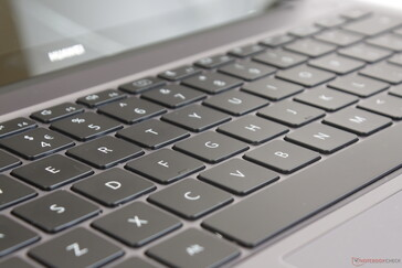 Shallow key travel and feel are reminiscent of the MacBook Air. Two-level white backlight comes standard