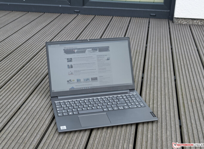 Using the ThinkBook 15 outdoors on a cloudy day.